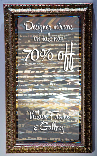 Designer mirror with these words superimposed over it: Designer Mirrors on sale now 70% off, Village Frame & Gallery